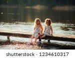 two little girl on the lake... | Shutterstock . vector #1234610317