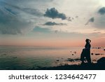 couple at dusk on the beach... | Shutterstock . vector #1234642477