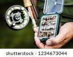 man holding open box of flies...   Shutterstock . vector #1234673044