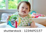 happy little baby boy playing... | Shutterstock . vector #1234692157