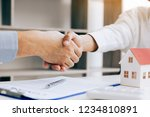 close up of shaking hands with... | Shutterstock . vector #1234810891