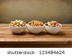 Nuts Assortment On Wooden Table