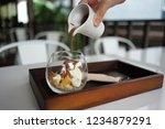 human hand pouring liquid... | Shutterstock . vector #1234879291