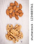healthy walnuts and almonds... | Shutterstock . vector #1234885561