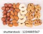 various nuts and almonds... | Shutterstock . vector #1234885567