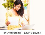 cheerful indian woman using...   Shutterstock . vector #1234915264
