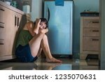 young scared and helpless asian ... | Shutterstock . vector #1235070631