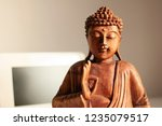 buddha statue inside the house... | Shutterstock . vector #1235079517