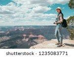 full length of asian traveler... | Shutterstock . vector #1235083771