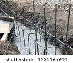 builders pour concrete into the ...   Shutterstock . vector #1235165944