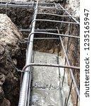 builders pour concrete into the ...   Shutterstock . vector #1235165947