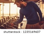 staying true to the weight... | Shutterstock . vector #1235169607