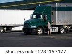 truck driver opening door of...   Shutterstock . vector #1235197177