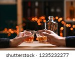 couple drinking whiskey in bar | Shutterstock . vector #1235232277