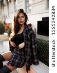 young fancy female in grey... | Shutterstock . vector #1235242834