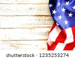 Small photo of Patriotic composition w/ ruffled American flag on black background. United States of America stars & stripes symbol with copy spase for text. 4th of july Independence day concept. Background, close up