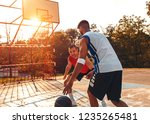 two friends playing basketball... | Shutterstock . vector #1235265481