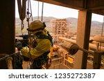 rope access technician wearing... | Shutterstock . vector #1235272387