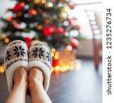 legs in slippers on christmas... | Shutterstock . vector #1235276734