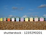 A row of ten colorful beach...