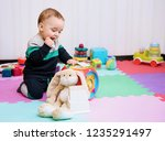 adorable baby boy playing with... | Shutterstock . vector #1235291497