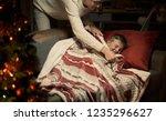 caring loving mother tucking...   Shutterstock . vector #1235296627