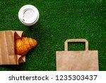 take out in paper bag on green...   Shutterstock . vector #1235303437