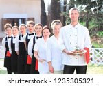 large group of waiters and... | Shutterstock . vector #1235305321