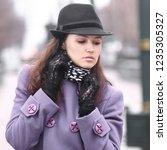 beautiful girl in a trendy hat... | Shutterstock . vector #1235305327
