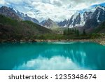 mountain lake on front of giant ... | Shutterstock . vector #1235348674