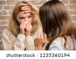 girl in scarf hold tissue while ... | Shutterstock . vector #1235360194