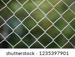 durable steel mesh fence | Shutterstock . vector #1235397901