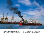 molass red cargo vessel is...   Shutterstock . vector #1235416534
