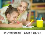 portrait of grandmother and... | Shutterstock . vector #1235418784