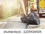 garbage bags on the sidewalk... | Shutterstock . vector #1235426434