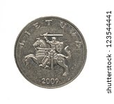 Small photo of One litas coin with national Lithuanian emblem isolated on white