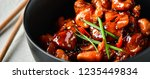 spicy chicken in sweet and sour ...   Shutterstock . vector #1235449834