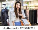 beautiful attractive happy... | Shutterstock . vector #1235489911