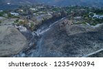 Burnt Landscape Of Woolsey Malibu Fire and Malibu State Creek park region with Fire Retardant visible