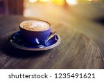 cup of coffee with beautiful... | Shutterstock . vector #1235491621