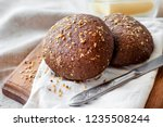 homemade rye buns with linseeds ... | Shutterstock . vector #1235508244