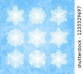 set of white snowflakes... | Shutterstock .eps vector #1235529697