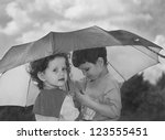 Little Girl And Boy Hiding...