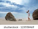 beach  sad beautiful woman | Shutterstock . vector #123558469