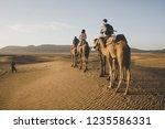 camel riding in zagora desert... | Shutterstock . vector #1235586331