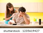 young family struggling with... | Shutterstock . vector #1235619427