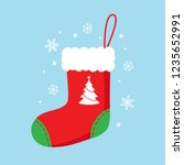 christmas sock in red color... | Shutterstock .eps vector #1235652991
