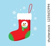 christmas sock in red color... | Shutterstock .eps vector #1235652994