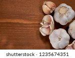 garlic and garlic cloves on... | Shutterstock . vector #1235674351