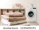 stack of clean soft towels on... | Shutterstock . vector #1235690191